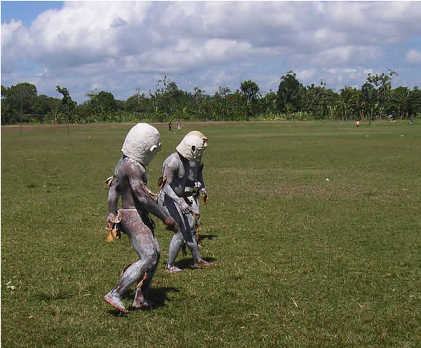 Mud men with masks like deep sea divers