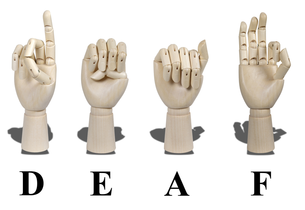 dummy hands making the word deaf in sign language
