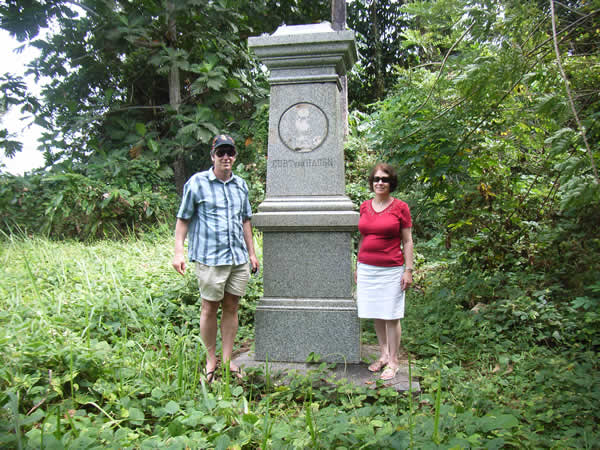 Jim and Gill standing next to a monument